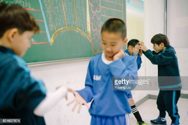 Muradil Muhammad and other students are play rockpaperscissors in break time March 19 2016 Meizhou of Guangdong Province is the hometown of soccer...