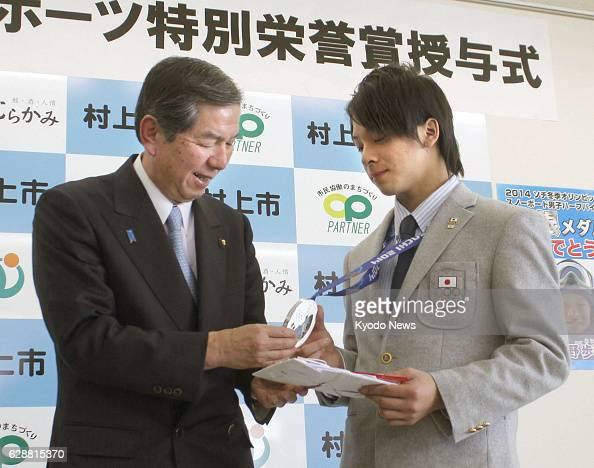 Murakami Japan Sochi Olympics men's snowboard halfpipe silver medalist Ayumu Hirano shows his medal to Hiramasa Otaki mayor of his hometown Murakami...