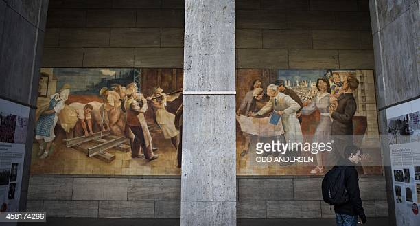 FALL A mural by communist era artist Max Lingner on the wall of the German finance ministry in Berlin on October 28 2014 The DetlevRohwedderHaus is a...