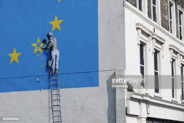 A mural by street artist Banksy depicting a European Union flag being chiseled by a workman covers the side of a building in Dover UK on Friday Sep...
