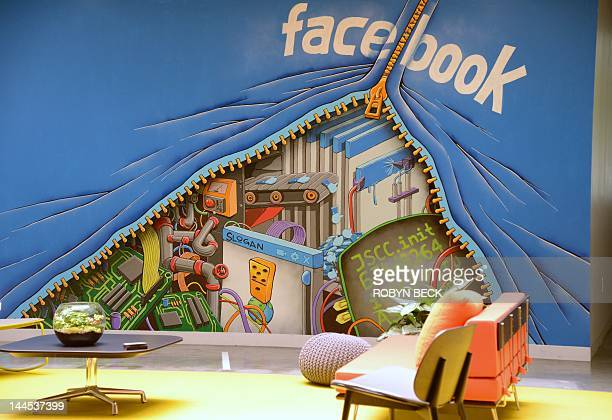 A mural decorates one of the many open space work areas at the Facebook headquarters in Menlo Park California May 15 2012 Facebook the world's most...