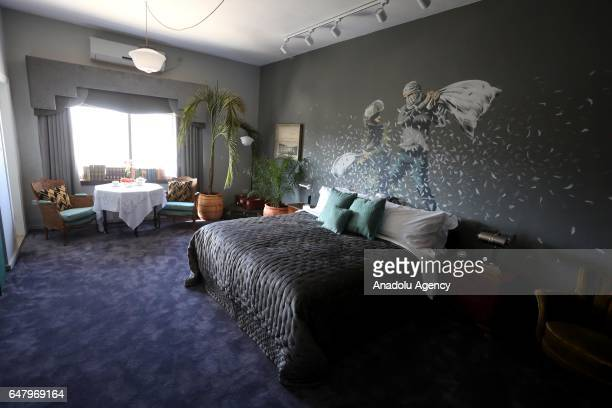 A mural in a room shows a soldier and a Palestinian make pillow fight at a hotel named 'The Walled Off' in Bethlehem in the southern West Bank which...