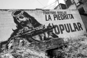 A mural in the Barrio 23 Enero area in the centre of Caracas about La Piedrita one of of the 'colectivos' of Caracas 'Colectivos' are criminal gangs...