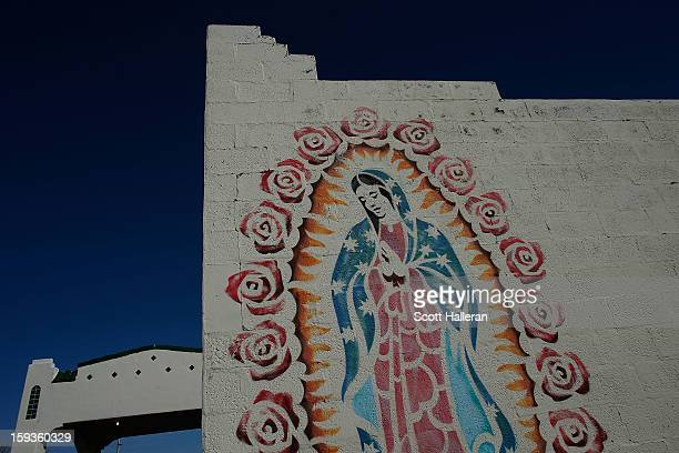 A mural is seen on December 25 2012 in Marfa Texas Situated in West Texas this town of just over 2000 residents has become a popular tourist...