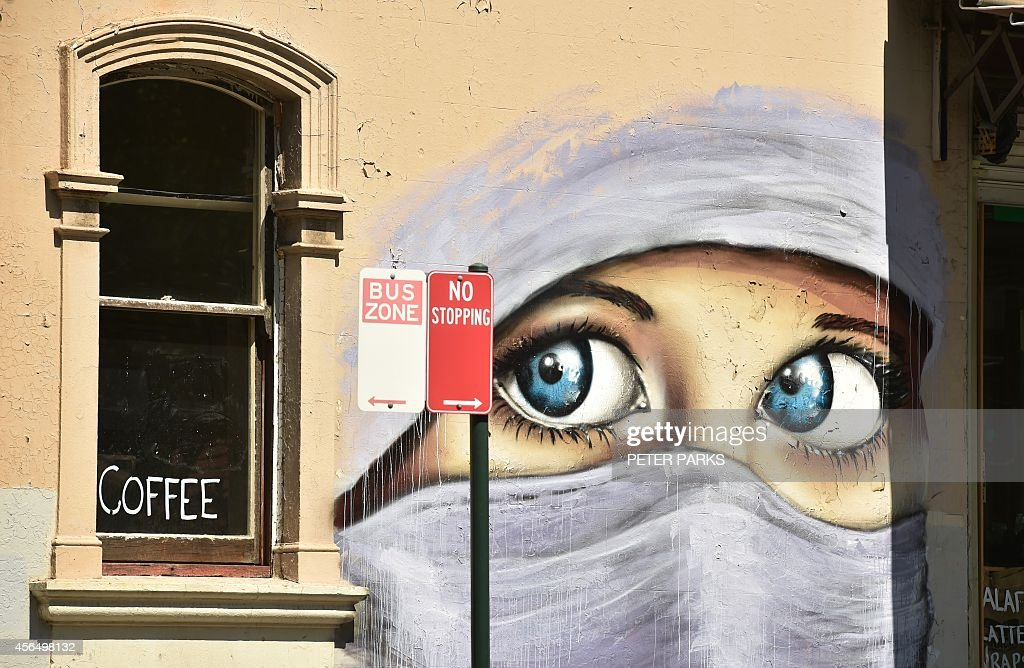 A mural of a Muslim woman painted on a wall in an inner city suburb of Sydney on October 2 2014 Australian military jets are to join in the USled air...