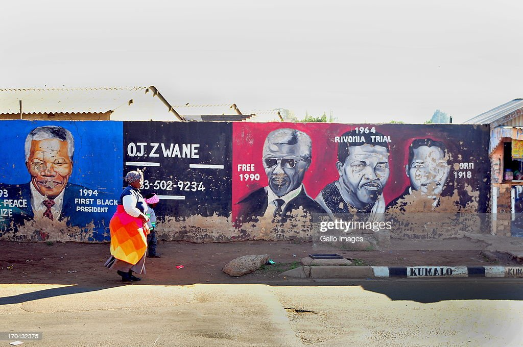 A mural of Mandela and struggle members on June 11, 2013 on Kumalo Road in Soweto, South Africa. Nelson Mandela has been admitted to hospital and it is reported he is in a serious but stable condition.