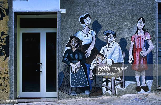 Mural of Sardinian family on a wall in Orgosolo in the Barbagia region.