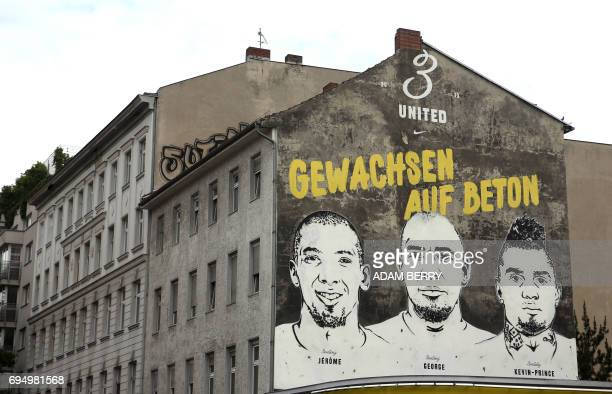 A mural of the brothers and football players Jerome George and KevinPrince Boateng under the words 'Grown On Concrete' is seen in the Wedding...