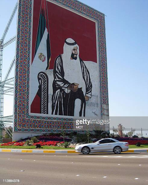 A mural of the late revered leader of the United Arab Emirates Sheikh Zayed bin Sultan al Nahyan stands in a busy traffic square in Abu Dhabi the...