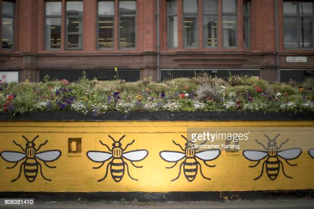 A mural of the worker bee adorns the side of a building in Manchester's northern quarter on July 3 2017 in Manchester England The Manchester worker...