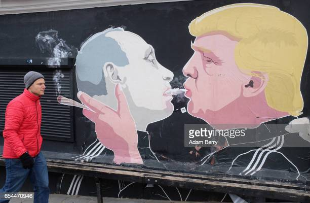 A mural of US President Donald Trump and Russian President Vladimir Putin 'shotgunning' a marijuana joint is seen on March 17 2017 in Vilnius...