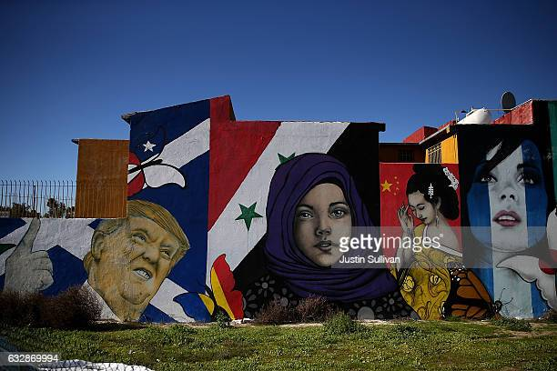 A mural of US President Donald Trump is displayed on the side of a home on January 27 2017 in Tijuana Mexico US President Donald Trump announced a...