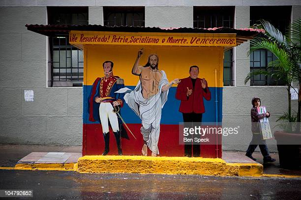 A mural on a kiosk in the centre of Caracas depicting liberator and national hero Simon Bolivar Jesus Christ and president Hugo Chavez
