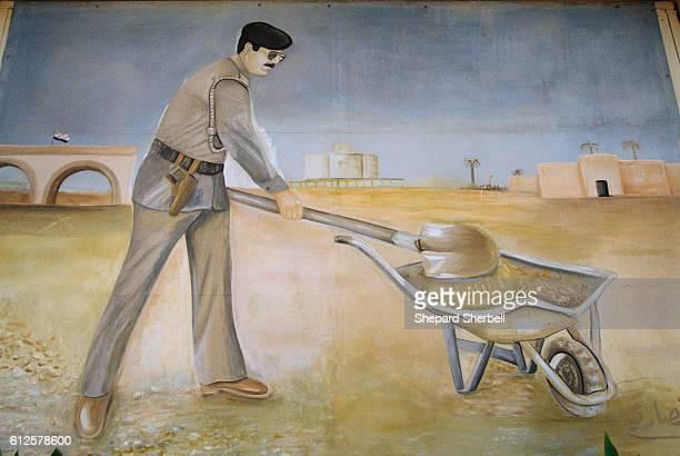 Mural Painting of Saddam Hussein with Shovel and Wheelbarrow