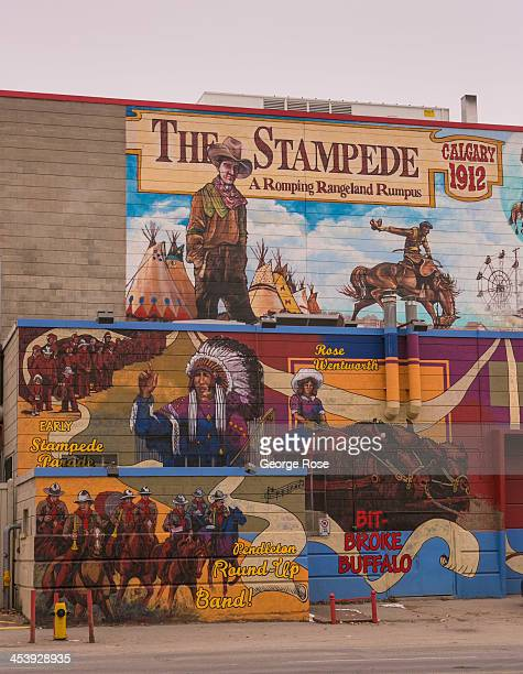 A mural promoting The Stampede the world's largest rodeo and outdoor event is viewed on November 8 2013 in Calgary Alberta Canada The region...