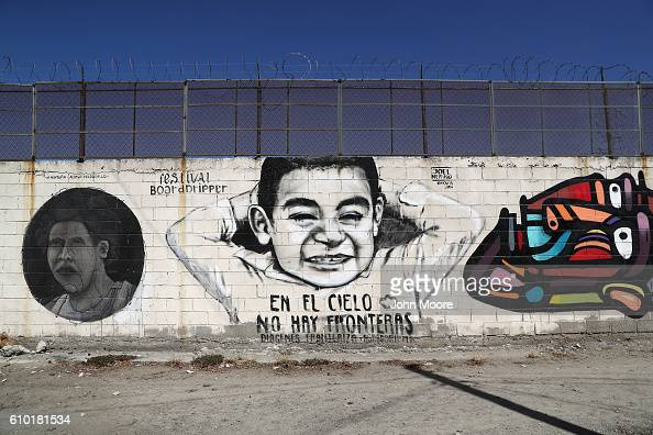 A mural reading 'In Heaven there are no borders' is painted on the Mexican side of the border wall on September 24 2016 in Tijuana Mexico Securing...
