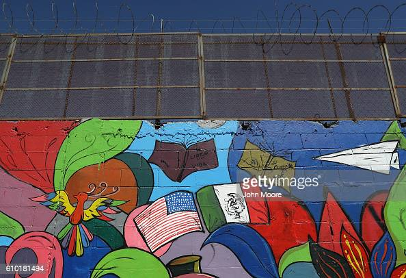 A mural stands painted on the Mexican side of the USMexico border wall on September 24 2016 in Tijuana Mexico Securing the border and controlling...