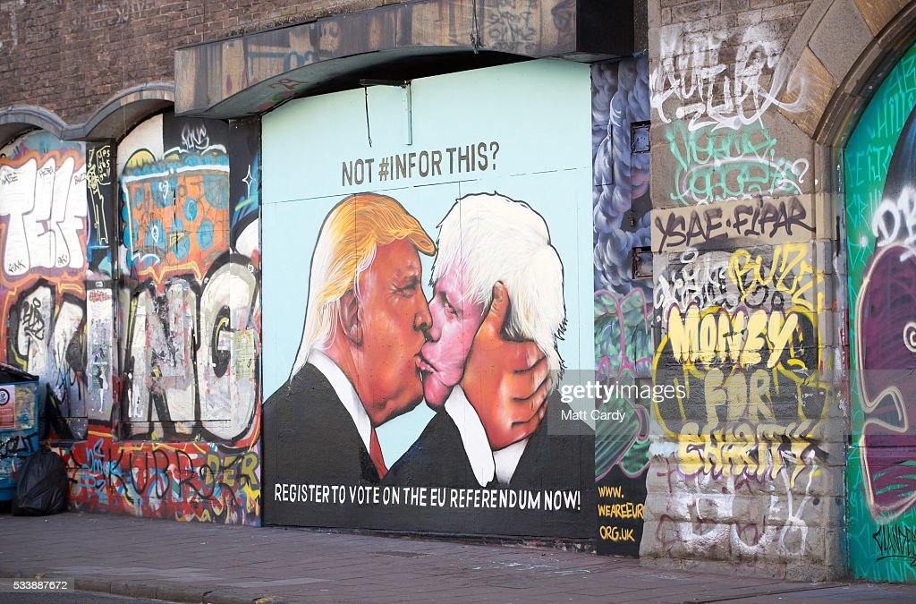 A mural that has been painted on a derelict building in Stokes Croft showing US presidential hopeful Donald Trump sharing a kiss with former London Mayor Boris Johnson is seen on May 24, 2016 in Bristol, England. Boris Johnson is currently one of the biggest names leading the campaign for Britain to leave the European Union in the referendum which takes place on June 23 and Republican presidential hopeful Donald Trump has also backed a so-called Brexit.
