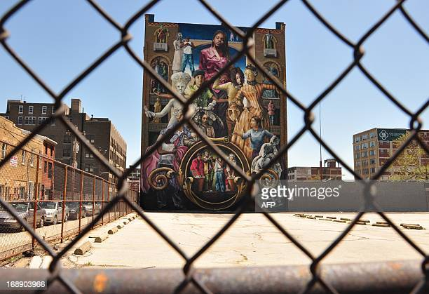 A mural towers over an empty parking lot in Philadelphia 30 April 2013 Philadelphia counts some 3800 murals across the city from historic downtown to...