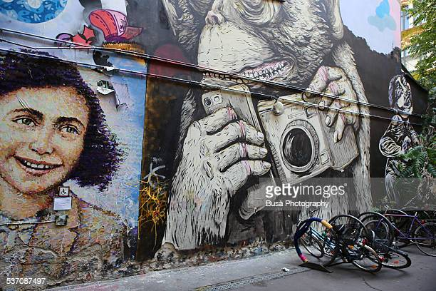 A mural with the portrait of Anne Frank