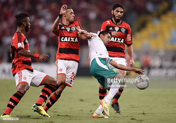 Muralha Paulinho and Wallace of Flamengo battles for the ball against Elias Hernandez of Leon during a match between Flamengo and Leon as part of...