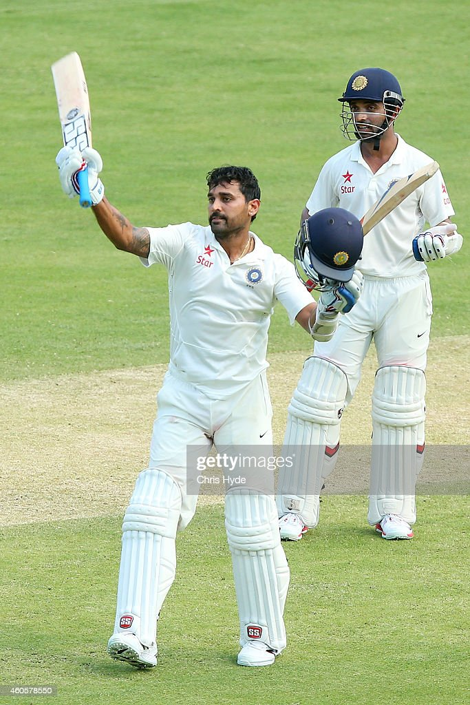 <a gi-track='captionPersonalityLinkClicked' href=/galleries/search?phrase=Murali+Vijay&family=editorial&specificpeople=5592328 ng-click='$event.stopPropagation()'>Murali Vijay</a> of India celebrates his century with team mate Ajinkya Rahan during day one of the 2nd Test match between Australia and India at The Gabba on December 17, 2014 in Brisbane, Australia.