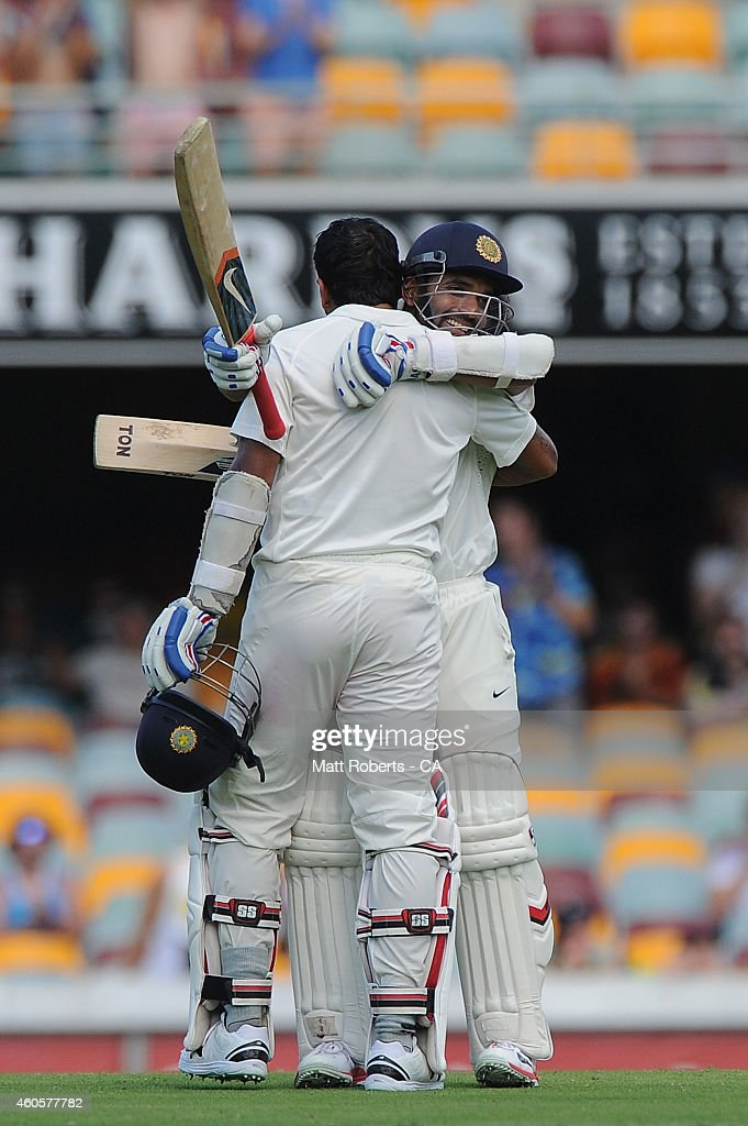 <a gi-track='captionPersonalityLinkClicked' href=/galleries/search?phrase=Murali+Vijay&family=editorial&specificpeople=5592328 ng-click='$event.stopPropagation()'>Murali Vijay</a> of India celebrates reaching his century with <a gi-track='captionPersonalityLinkClicked' href=/galleries/search?phrase=Ajinkya+Rahane&family=editorial&specificpeople=5839345 ng-click='$event.stopPropagation()'>Ajinkya Rahane</a> (R) during day one of the 2nd Test match between Australia and India at The Gabba on December 17, 2014 in Brisbane, Australia.