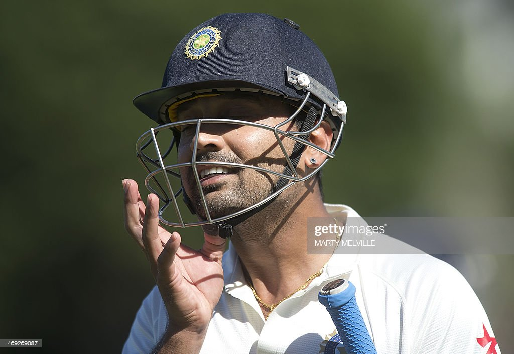 Murali Vijay of India walks from the field after being caught out on the first day of the second cricket Test between New Zealand and India in Wellington on February 14, 2014. AFP PHOTO / MARTY MELVILLE