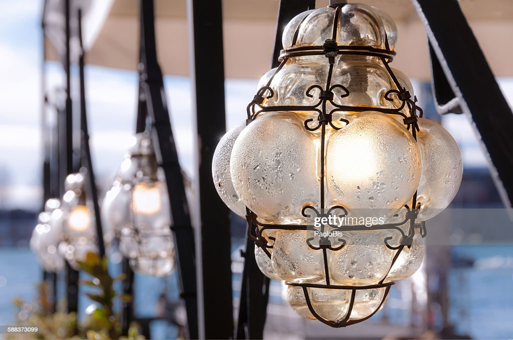 murano glass lamps on the streets of venice stock photo