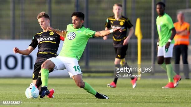 Murat Saglam of Wolfsburg challenges Dzenis Burnic of Dortmund during the U19 German Championship Semi Final second leg match between Borussia...