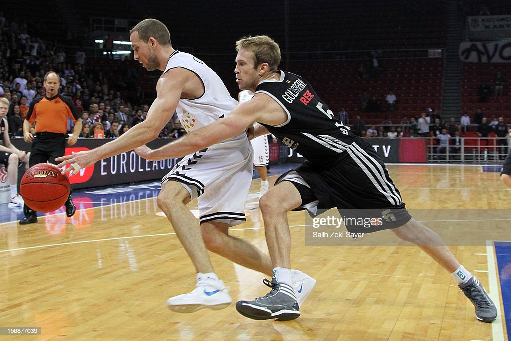 Muratcan Guler of Besiktas JK Istanbul competes with #5 John Goldsberry of Brose Baskets Bamberg during the 2012-2013 Turkish Airlines Euroleague Regular Season Game Day 7 between Besiktas JK Istanbul v Brose Baskets Bamberg at Abdi Ipekci Arena on November 23, 2012 in Istanbul, Turkey.