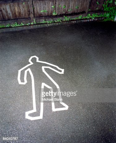 Murder crime scene with white outline of man : Stock Photo