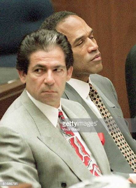 Murder defendant OJ Simpson listens to testimony by the Los Angeles County Coroner 07 June on how his exwife Nicole Brown Simpson died of a deep...