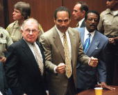 Murder defendant OJ Simpson listens to the not guilty verdict with his attorneys F Lee Bailey and Johnnie Cochran Jr Simpson was found not guilty of...