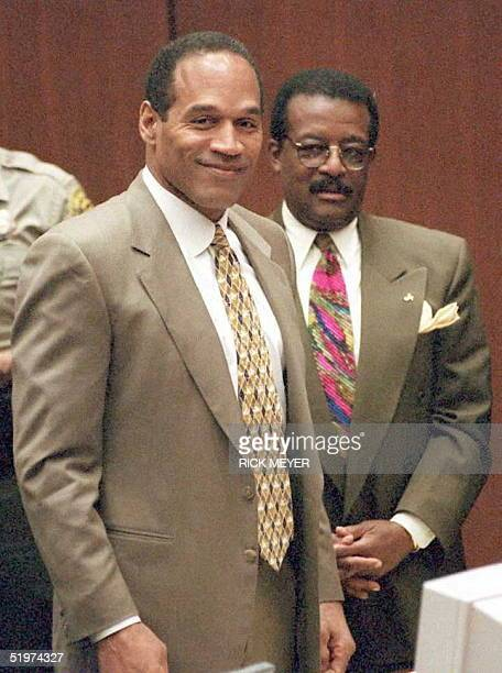 Murder defendant OJ Simpson smiles as the jury enters the courtroom in the OJ Simpson double murder trial 15 May Lead defense attorney Johnnie...