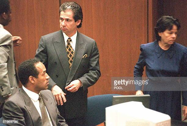 Murder defendant OJ Simpson watches defense witness Rosa Lopez enter the court for a hearing on how her testimony will be heard 27 February Superior...
