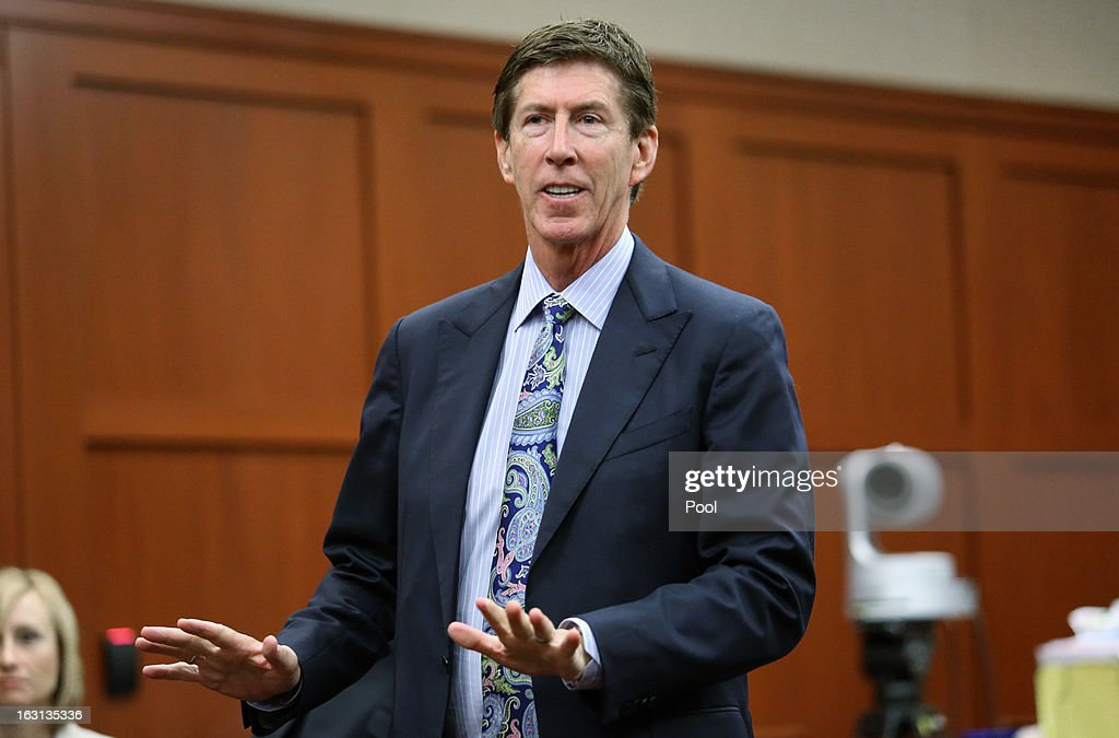 Murder suspect George Zimmerman's defense attorney Mark O'Mara speaks during a recess at a status hearing in the Trayvon Martin case, in Seminole circuit court March 5, 2013 in Sanford, Florida. The defense lawyers were reportedly looking for more access to the FBI's investigation into possible civil rights violations in the shooting of Martin.