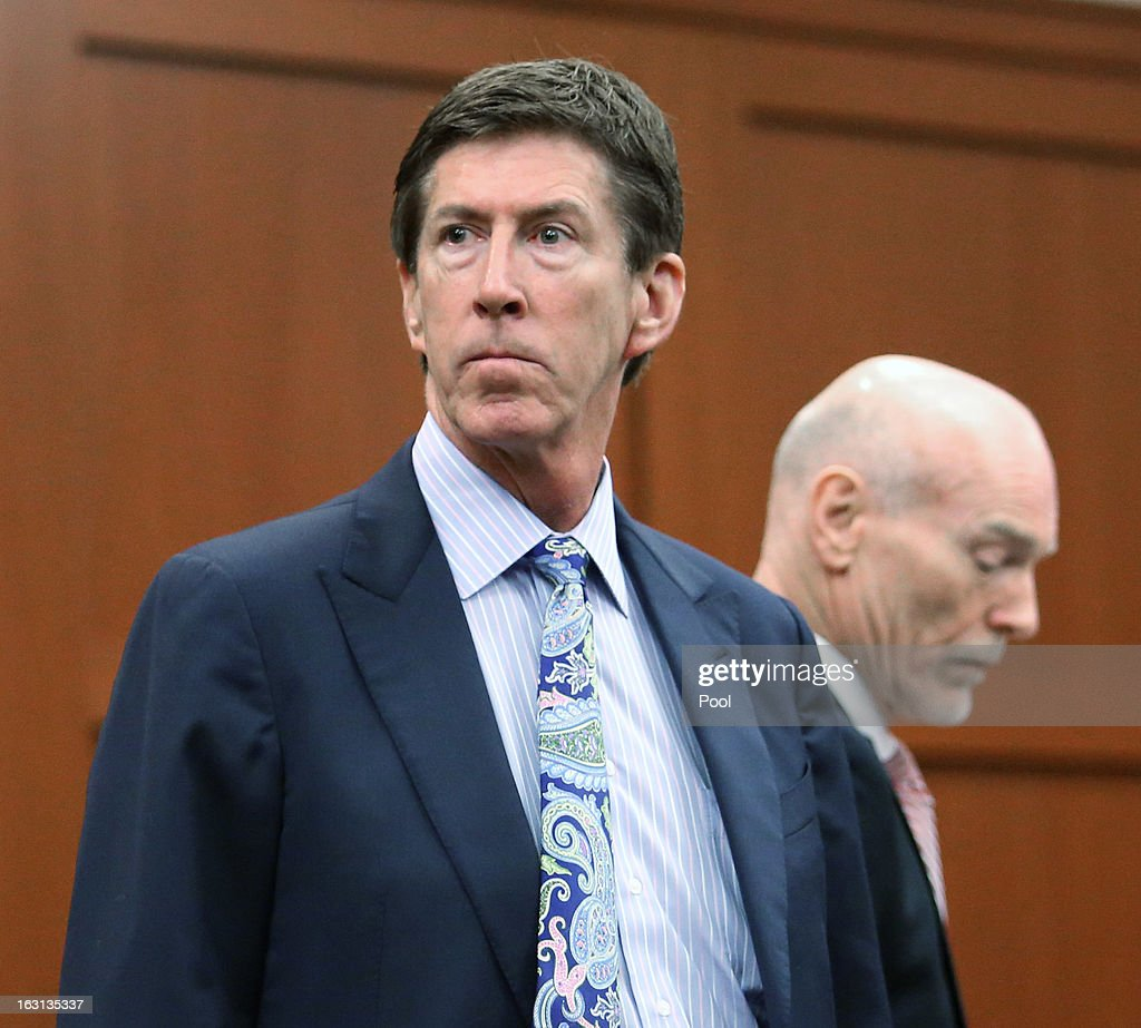 Murder suspect George Zimmerman's defense attorneys Mark O'Mara (L) and Don West stand during a recess at a status hearing in the Trayvon Martin case, in Seminole circuit court March 5, 2013 in Sanford, Florida. The defense lawyers were reportedly looking for more access to the FBI's investigation into possible civil rights violations in the shooting of Martin.