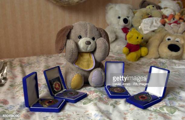 Murder victim Heather Tell's good luck charm 'Pupsie' with some of her National Dance medals photographed in her bedroom in Tamworth Staffordshire...