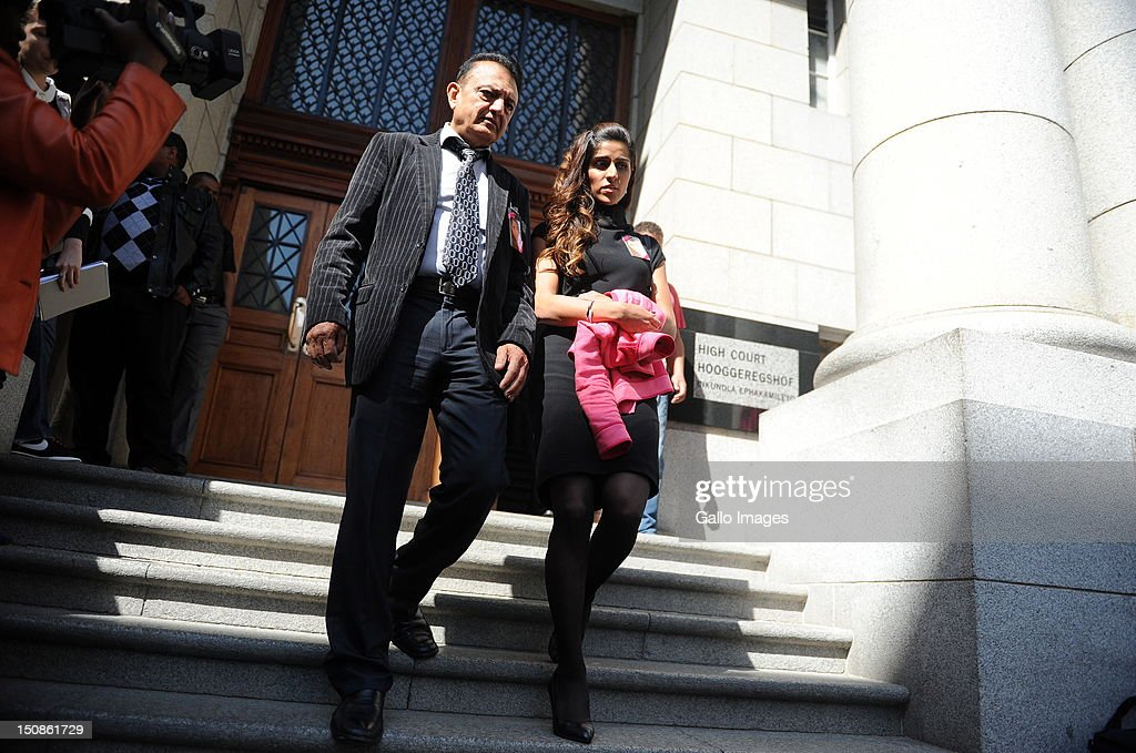 Murdered honeymooner Anni Dewani's father, Vinod Hindocha with Anni's niece outside the Western Cape High Court, where suspect Xolile Mngeni appears in connection with the murder of Anni Dewani, on August 28, 2012 in Cape Town, South Africa. Mngeni is accused of pulling the trigger on Anni, in a murder allegedly plotted by her British husband Shrien Dewani.