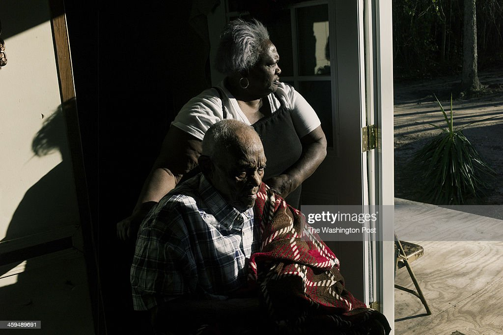 Murie Blount, 68, helps her father Chocolate Blount maneuver his wheelchair through their trailer home. Chocolate Blount, who is 91, was discharged from hospice care after years of assistance and improving health. He was recently enrolled again in hospice and receives home visits weekly.