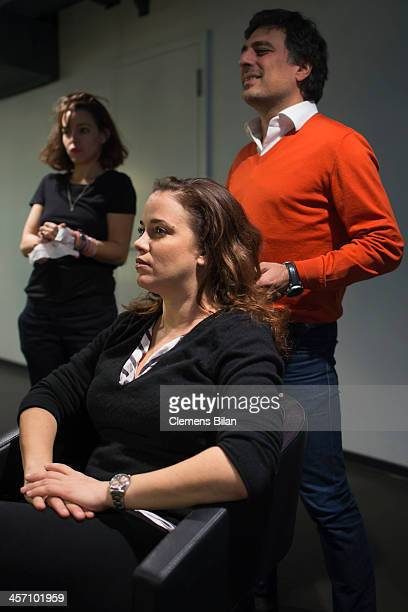 Muriel Baumeister is getting make up during a shoot for AMREF in Salon Shan Rahimkhan while Shan Rahimkhan stands behind her on December 16 2013 in...