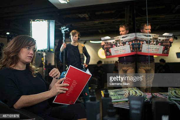 Muriel Baumeister sits during a shoot for AMREF in Salon Shan Rahimkhan on December 16 2013 in Berlin Germany