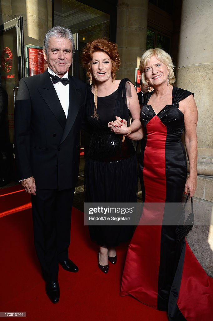 Muriel Mayette (C), Claude Serillon (L) and his companion attend the Le Grand Bal De La Comedie Francaise at La Comedie Francaise on July 4, 2013 in Paris, France.