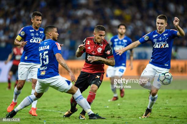 Murilo and Ezequiel of Cruzeiro struggles for the ball with Guerrero of Flamengo during a match between Cruzeiro and Flamengo as part of Copa do...