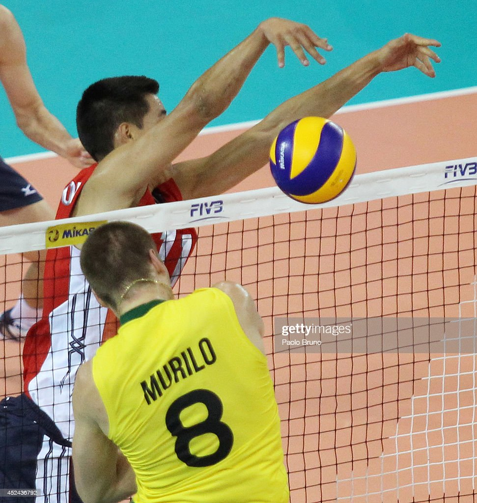 Murilo Endres of Brazil spikes the ball as Matthew Anderson of United States blocks during the FIVB World League Final Six match for the first place between United States and Brazil at Mandela Forum on July 20, 2014 in Florence, Italy.
