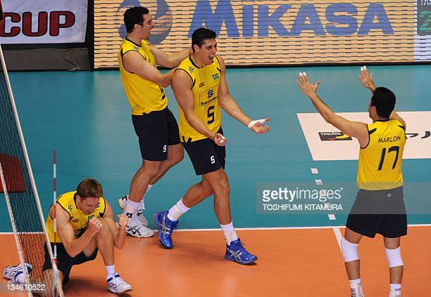 Murilo Endres Theo Lopes Sidnei dos Santos Jr and Marlon Muraguti Yared of Brazil celebrate their victory over Poland during their FIVB Men's World...