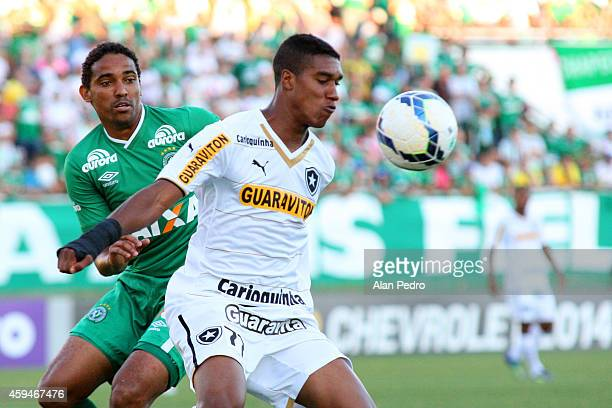 Murilo of Botafogo struggles for the ball with a Rafael Lima of Chapecoese during a match between Chapecoense and Botafogo for the Brazilian Series A...