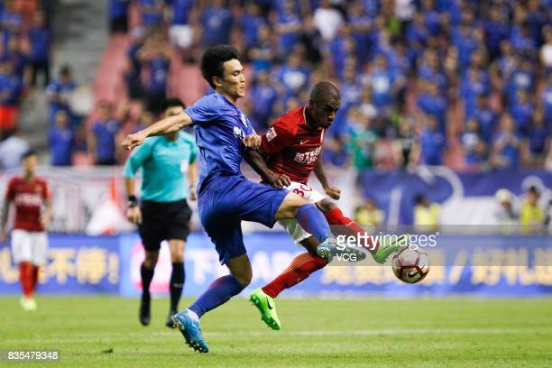 Muriqui of Guangzhou Evergrande and Kim KeeHee of Shanghai Shenhua compete for the ball during the 23rd round match of 2017 Chinese Football...