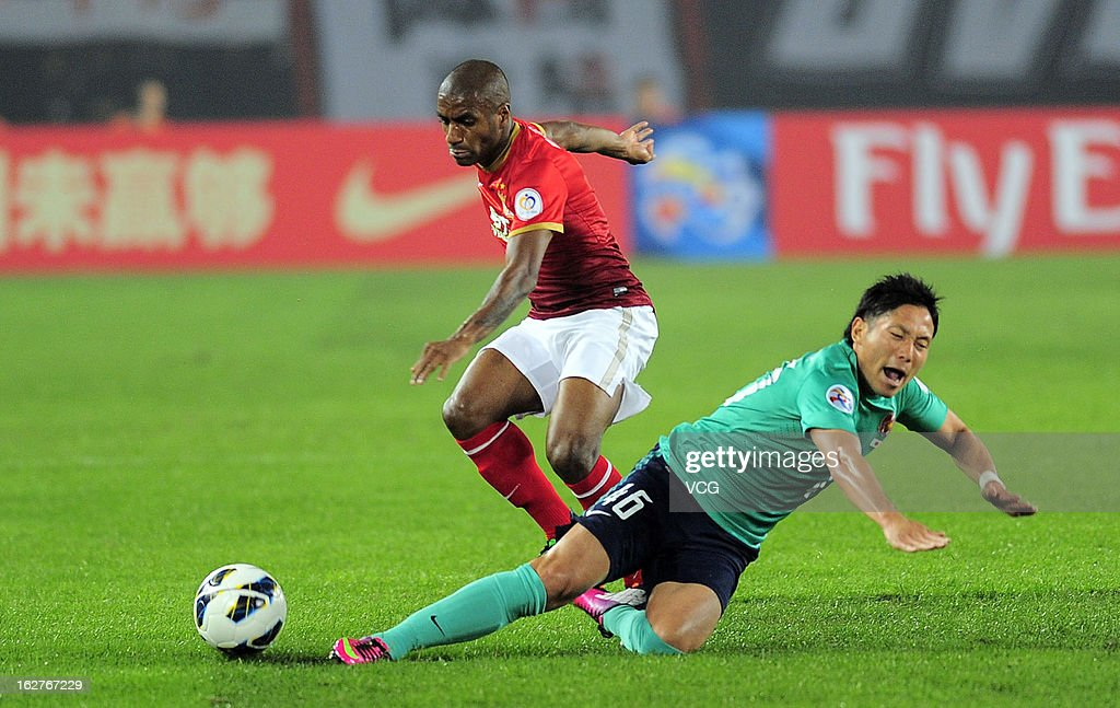 Muriqui (L) of Guangzhou Evergrande and Ryota Moriwaki (R) of Urawa Red Diamonds battle for the ball during the AFC Champions League match between Guangzhou Evergrande and Urawa Red Diamonds at Tianhe Sports Center on February 26, 2013 in Guangzhou, China.